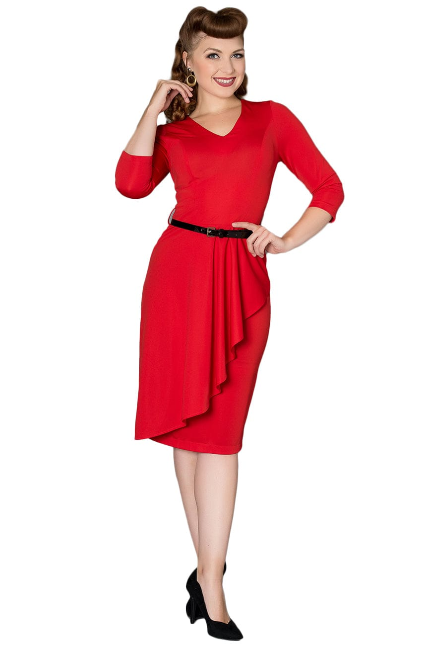 Timeless London red Katie dress features a ruffled A-line waterfall front detail over a fitted pencil skirt. With V-neck and thin black belt at fitted waist. Made sustainably.