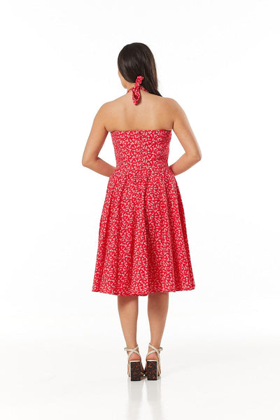 Kimberley red and white floral swing dress, with frill trim on sweetheart v-neck fitted bodice and halter neck. Made sustainably.