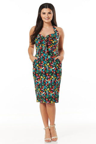 Pippa classic black halter neck fitted wiggle dress, with green, teal, blue, red, yellow purple multicoloured hawaiian floral leaf print. Features sweetheart neckline with adjustable central tie bow and knife pleats on fitted pencil skirts. Made sustainably.