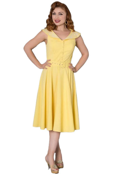 Timeless London yellow Freda swing dress, featuring an oversized collar with white floral embroidery on a wide V-neck with a matching chunky belt on a fitted waist. Made sustainably.
