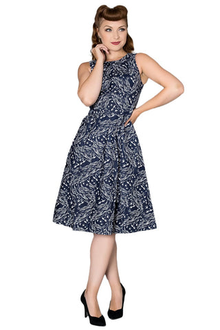 Timeless London navy blue Zabrina swing dress features white floral bird print and high neck Audrey Hepburn style. Made sustainably.