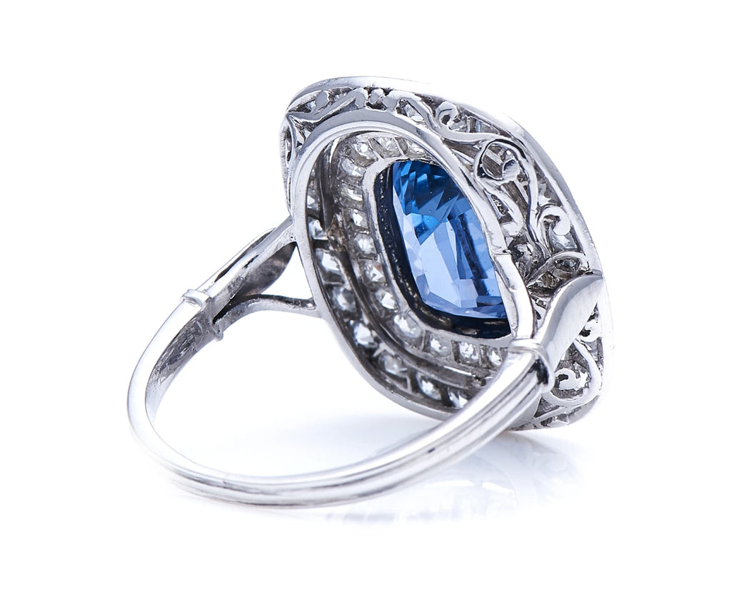 Edwardian, Platinum, Natural 'Cornflower' Ceylon Sapphire and Double Row Diamond Cluster Ring