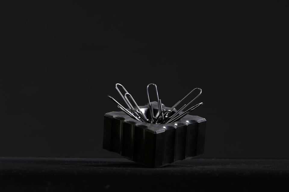 black paperclip holder