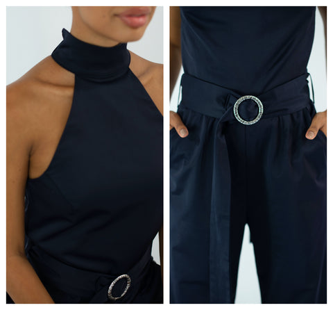 navy jumpsuit close up of halter neck and belt
