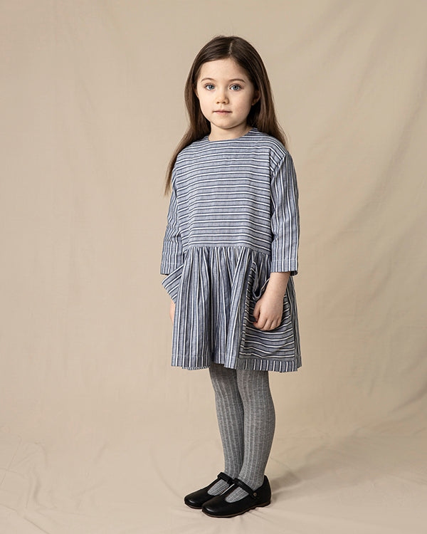 Pocket dress in navy stripes. Made from organic cotton, Icelandic design.