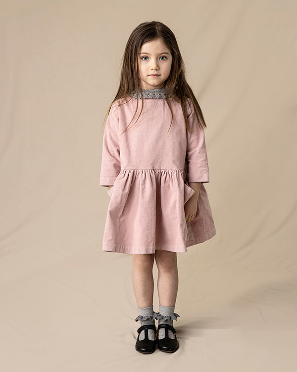 Pocket dress in pink, made from organic cotton. Icelandic design.