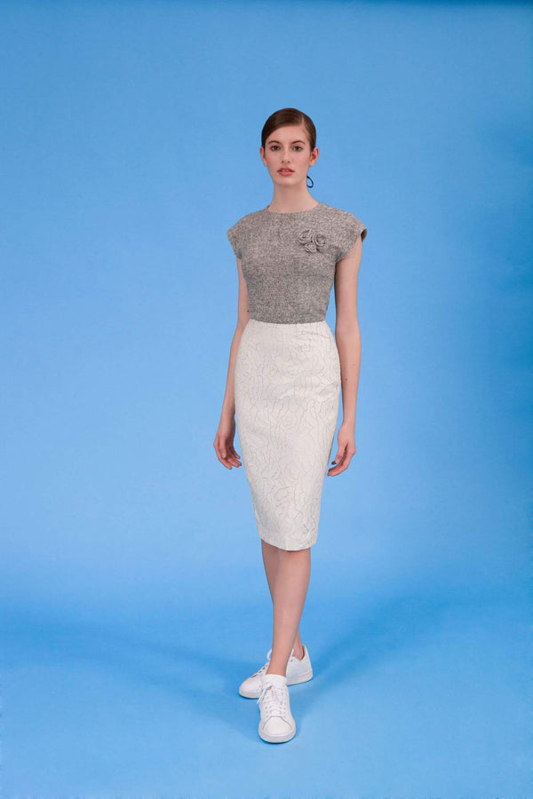 Laser cut faux leather pencil skirt in icy ivory front view