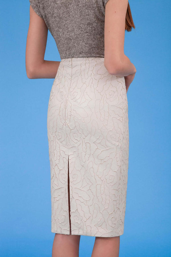 Laser cut faux leather pencil skirt in icy ivory rear view
