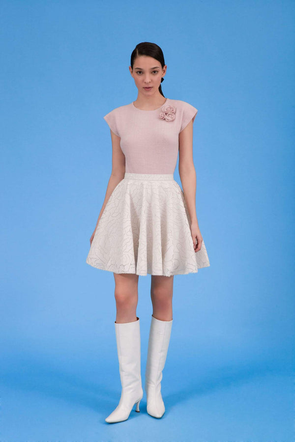 Front view of Audrey faux leather laser cut skirt in icy ivory