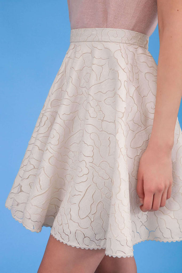 Closer look of Audrey faux leather laser cut skirt in icy ivory