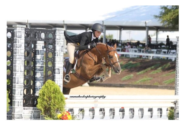 pony jumping fence at pony finals