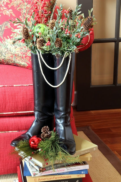 Horse riding tall boots with holiday garland