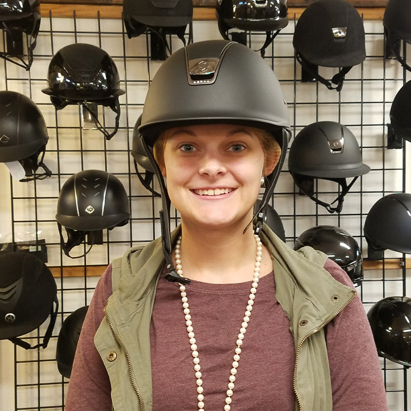 trying on a riding helmet