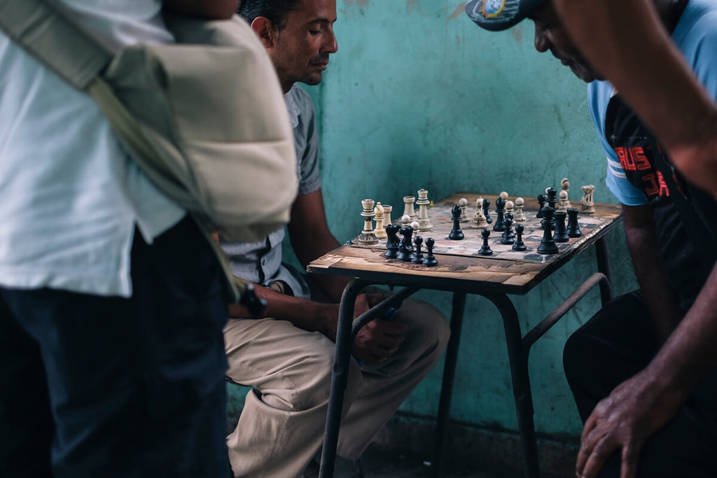 Men on the streets of Cuba playing chess