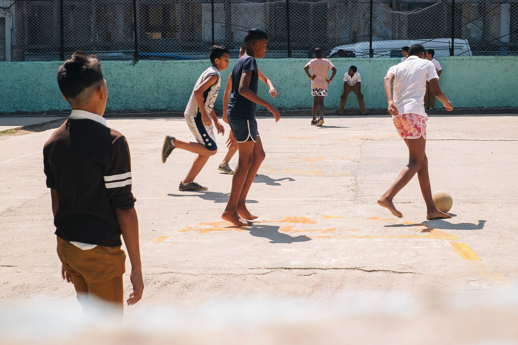 Boys playing football in Havana Cuba