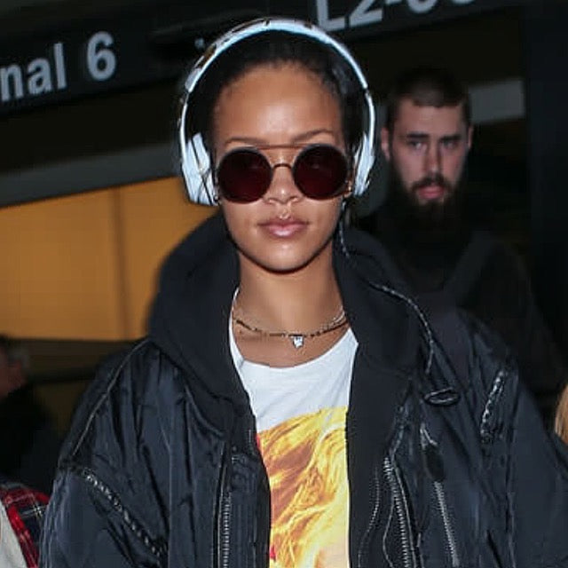 Rihanna Airport style wearing headphones and round sunglasses