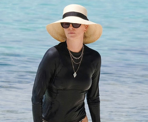 CHARLIZE THERON WEARS THE LAURA