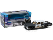 "Load image into Gallery viewer, ""Blues Brother's - Bluemobile"" 1974 Dodge Monaco 1:24 Scale - Greenlight Diecast Model Car"