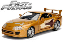 "Load image into Gallery viewer, ""Fast & Furious"" Slap Jack's Toyota Supra 1:24 Scale - Jada Diecast Model (Gold)"