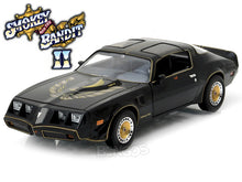 "Load image into Gallery viewer, ""Smokey and the Bandit II"" 1980 Pontiac Trans Am (T/A) Firebird 1:24 Scale - Greenlight Diecast Model Car"