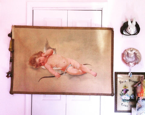 19th century hand-painted cherub wall hanging