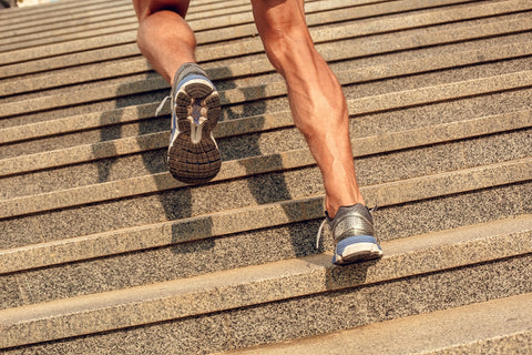 athletic mans legs running up stairs cbd blog