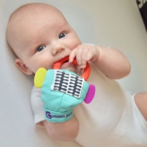 gummee glove teething mitten for babies chewing on detachable heart teether in use