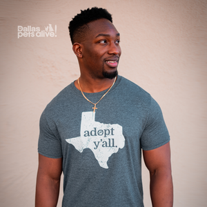 smiling man wearing Dallas Pets Alive! Adopt Y'all grey short-sleeve t-shirt