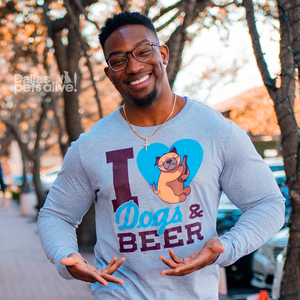 smiling male wearing grey long sleeve t-shirt with I HEART DOGS & BEER on the front