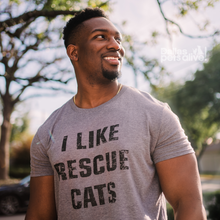 Load image into Gallery viewer, smiling male wearing grey Dallas Pets Alive! short-sleeve t-shirt with I LIKE RESCUE CATS printed on it