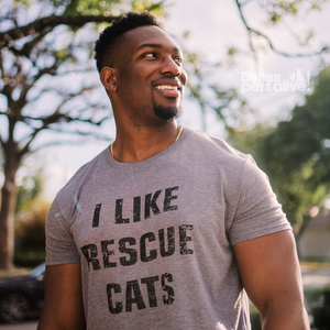 smiling male wearing grey Dallas Pets Alive! short-sleeve t-shirt with I LIKE RESCUE CATS printed on it