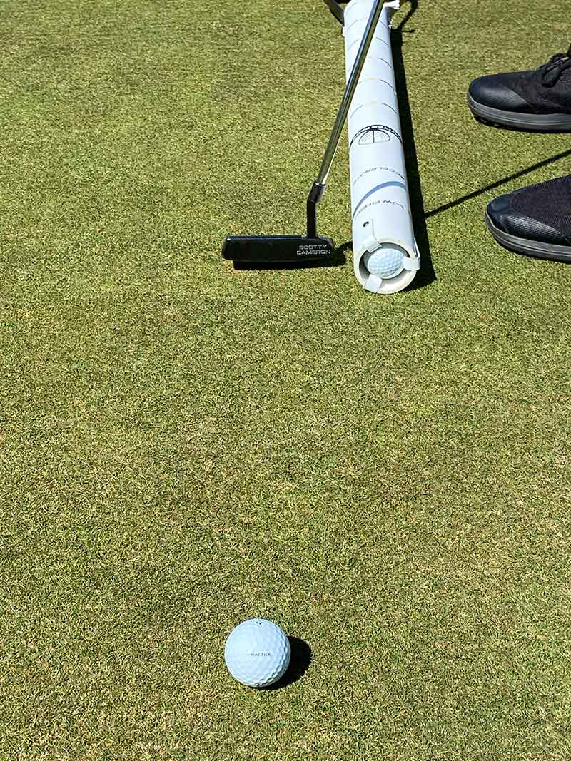 Keeping putter head accelerating and low through the stroke.