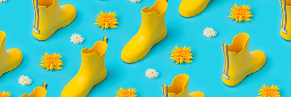 Cirrus Kids Chelsea Rain Boots in School Bus repeating with yellow and white flowers between