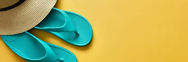 Women's Ara Flip Flop in Splash Blue with a sun hat on a sunny yellow background