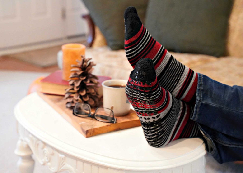 Men's Toastie Slipper Socks in Dog Print Stripe sitting up on a coffee table
