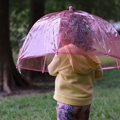 Kid's Clear Bubble Umbrella in Pink With Model