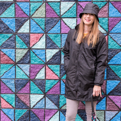 Women's Three Season Mid-length Storm Jacket in Black On Model With Black Rain Bucket Hat