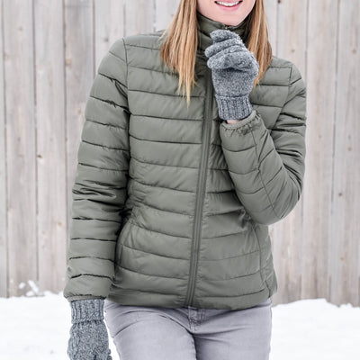 Women's Packable Puffer Jacket in Khaki On Model In The Snow