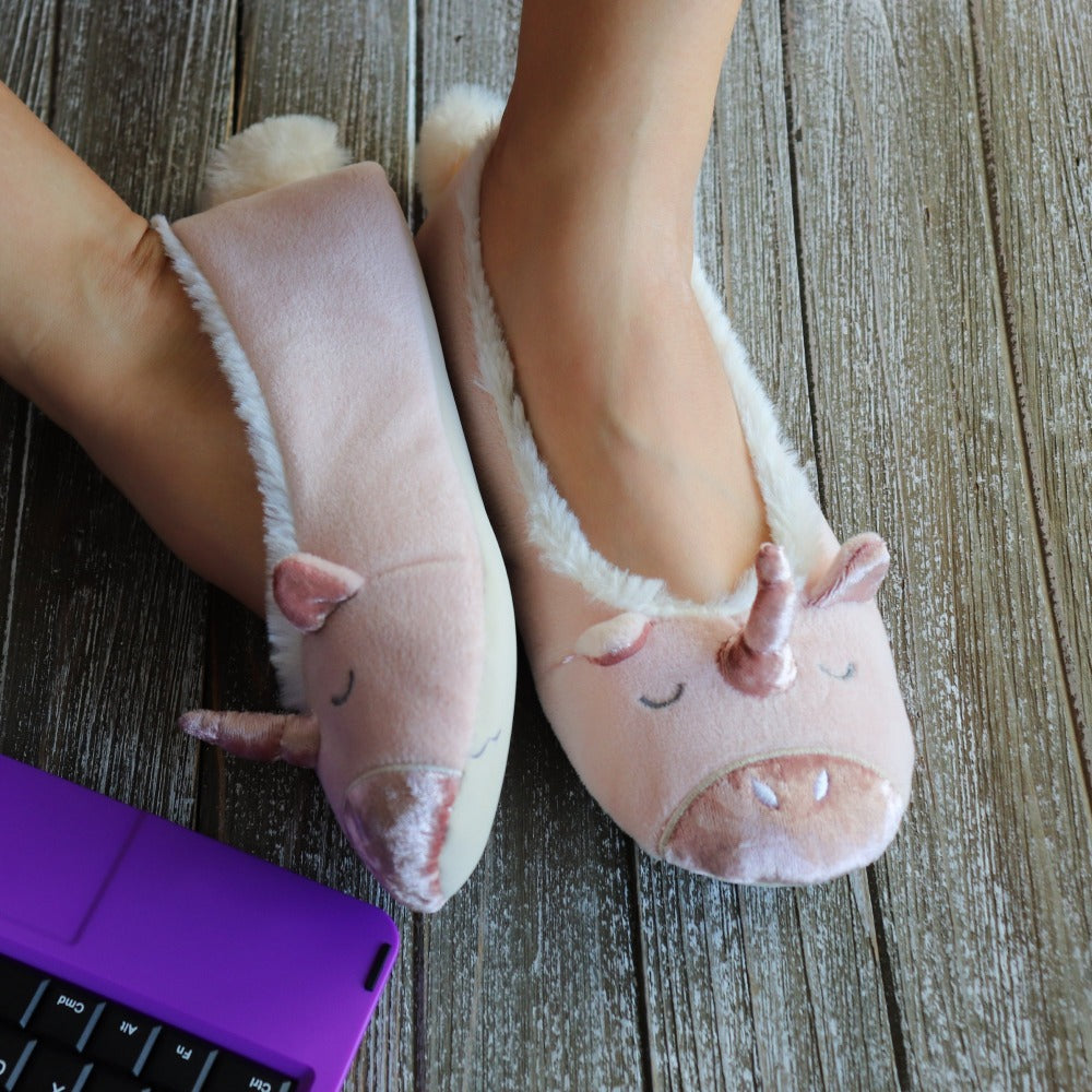 Woman wearing Women's Velvet Unicorn Ballet Slippers on wooden table