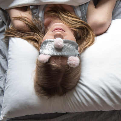 Woman wearing Women's Novelty Ballet Slipper and Eye Mask Set in mouse about to lay down for bed
