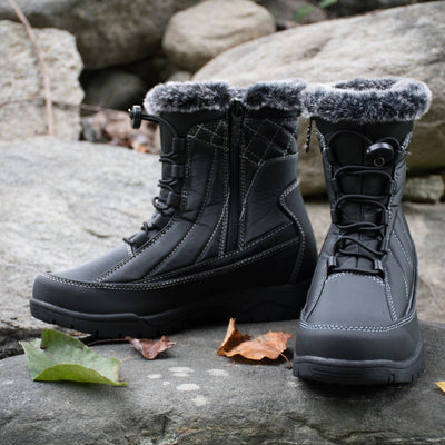 Flat lay of Women's Eve Winter Boots in black on rocks