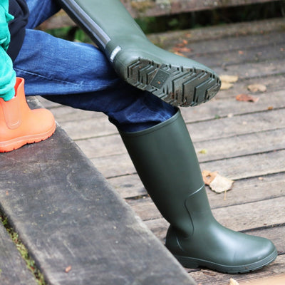 Cirrus™ Women's Claire Tall Rain Boots in Loden On Model Sitting Down