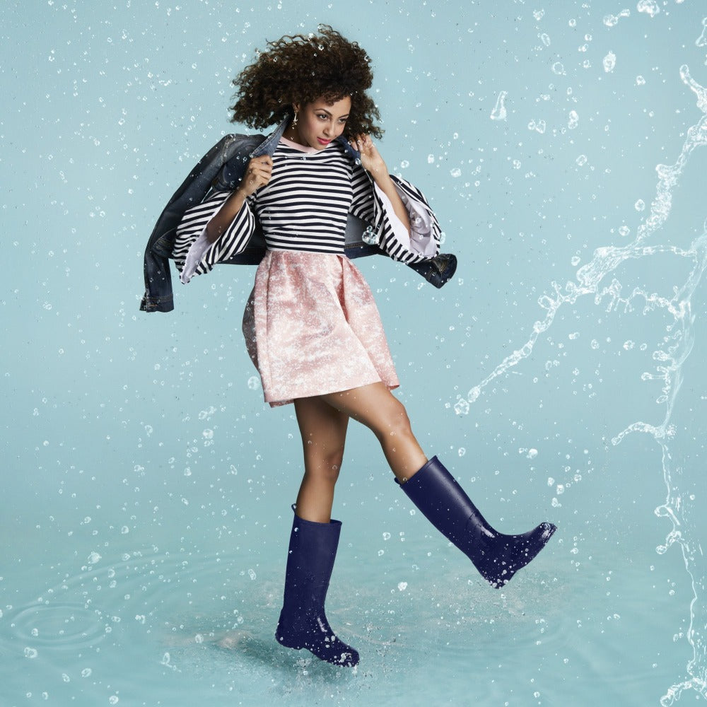 Cirrus™ Women's Claire Tall Rain Boots in Navy Blue On Model in the Rain