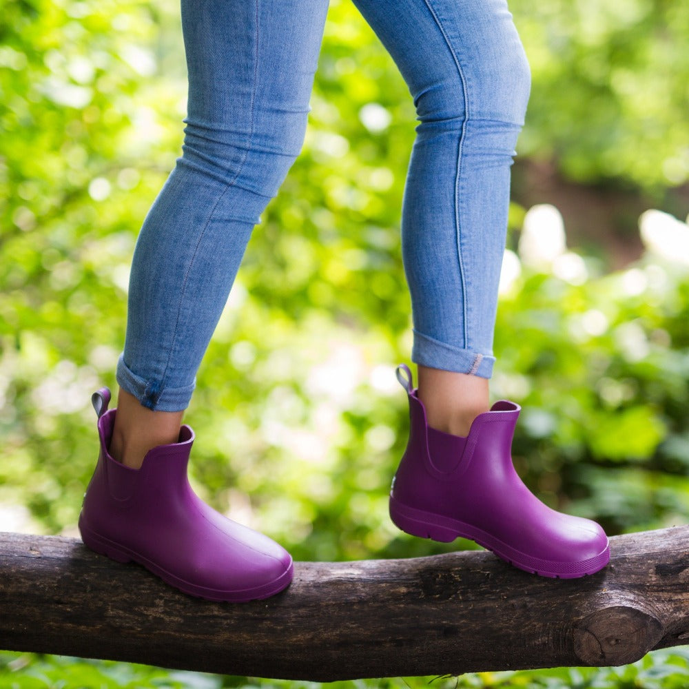 Cirrus™ Women's Chelsea Ankle Rain Boots in Red Grape On Model Walking on Branch