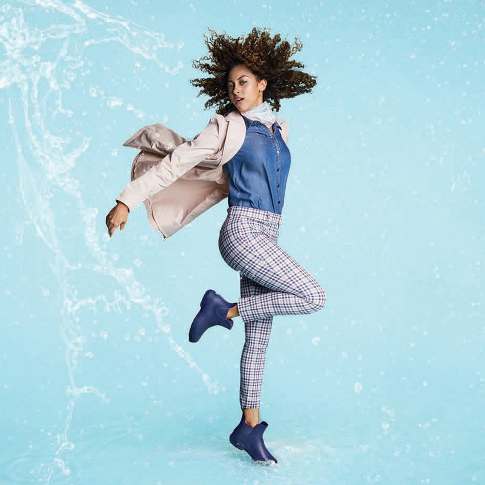 Cirrus™ Women's Chelsea Ankle Rain Boots in Navy Blue On Model in the Rain