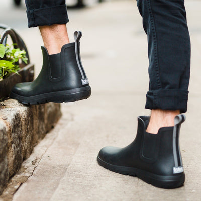 Cirrus™ Men's Chelsea Ankle Rain Boot in Black On Model Outside