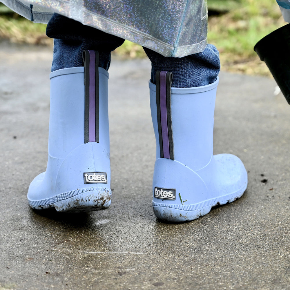 Cirrus™ Toddler's Charley Tall Rain Boot in Bonnie Blue on model in a rain coat outside
