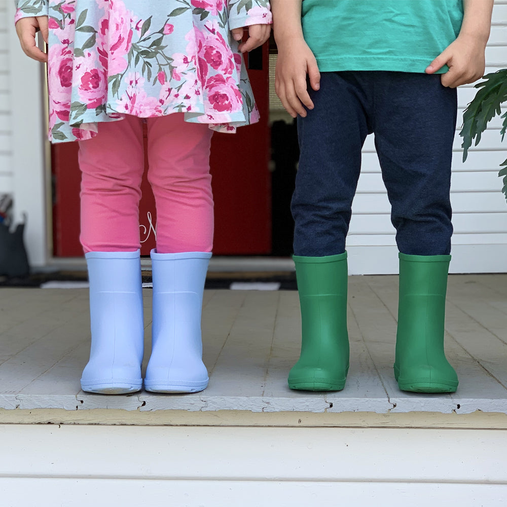 Cirrus™ Toddler's Charley Tall Rain Boot in Bonnie Blue and Classic Green on models standing on the front porch