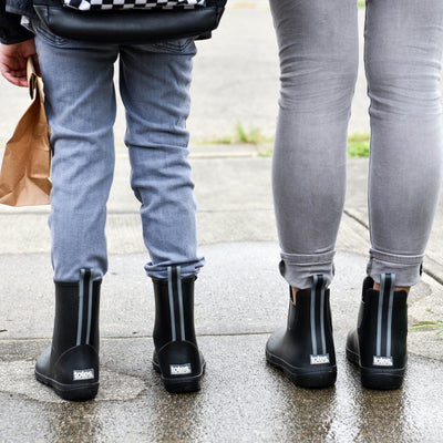 Cirrus™ Kid's Charley Tall Rain Boot in Black On Model with Matching Women's Chelsea Boot in Black