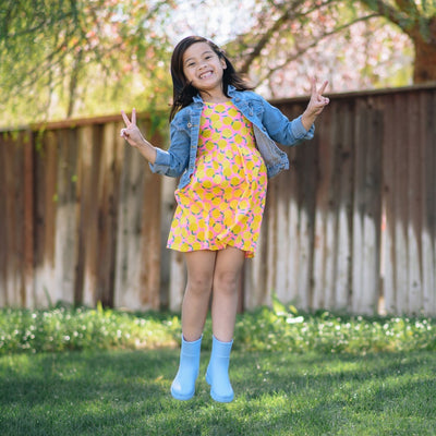 Cirrus™ Kid's Charley Tall Rain Boot in Bonnie Blue On Model Jumping